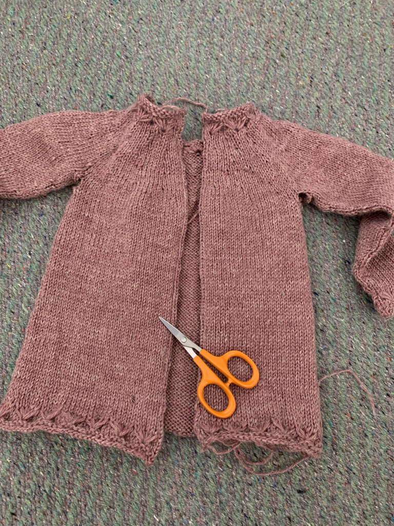 Knitted cardigan steeked open